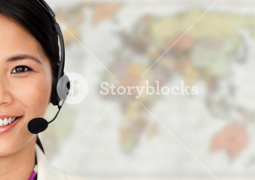 Close up of travel agent with headset against blurry map