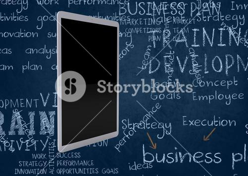 Tablet against blackboard with chalk business words