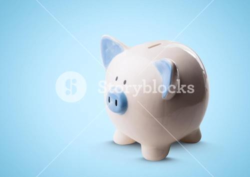 Piggy bank against blue background