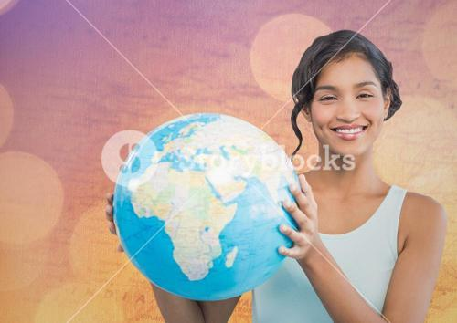 Woman with globe against map with bokeh