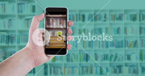 Hand with phone showing book pile with apple against blurry bookshelf with blue overlay