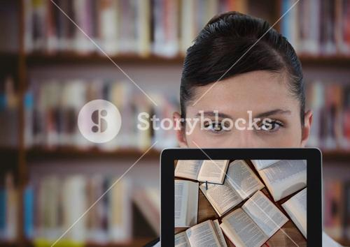 Woman with tablet showing open books against blurry bookshelf