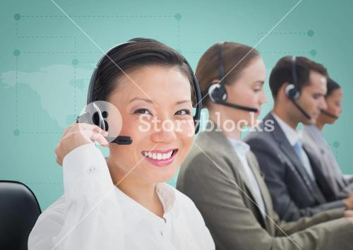 Travel agents with headsets against green map