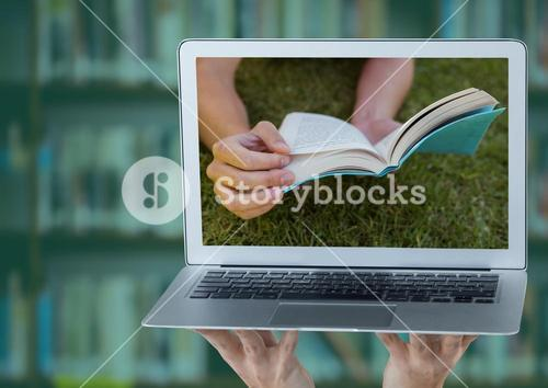 Hands with laptop showing book on grass against blurry bookshelf with green overlay