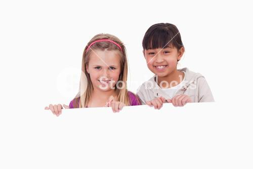 Girls behind a blank panel