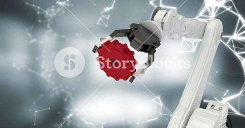 White robot claw with red cog and white interface against blurry grey room