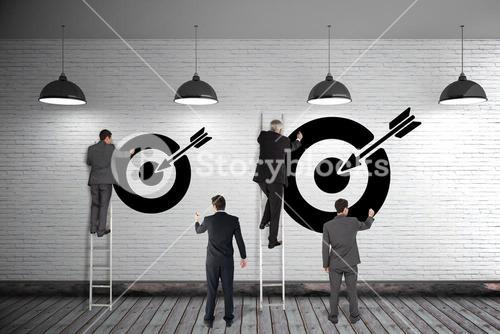 Group of business men writing on  3d wall with targets