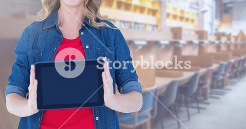 woman holding tablet in Library