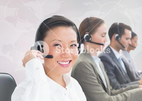 Travel agents with headsets against white map