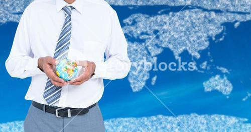 Travel agent mid section holding globe against map with clouds and blue background