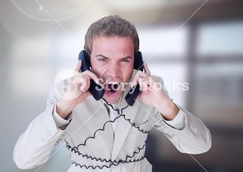 Stressed man on telephones in office