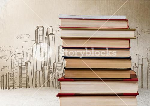 Books stacked by city drawings