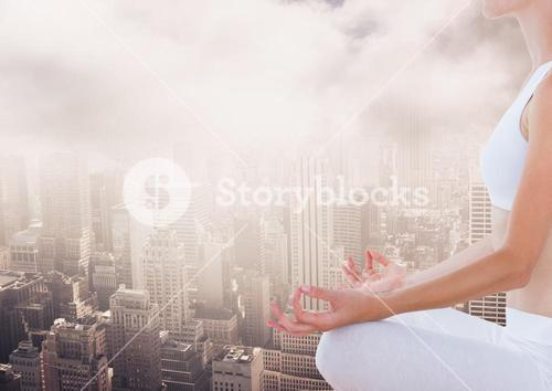 Woman Meditating peaceful over city