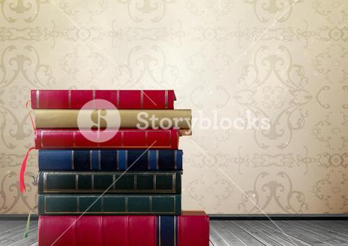 Books stacked by rustic wallpaper