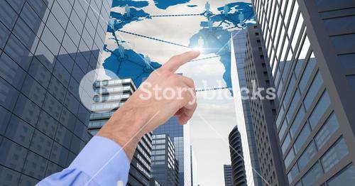 hand pointing at City with world map