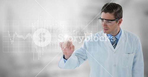 Man in lab coat and goggles pointing at white graph and flare against grey background