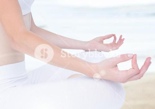Hands Meditating by sea haze