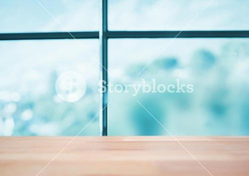 Wood table against blurry blue window