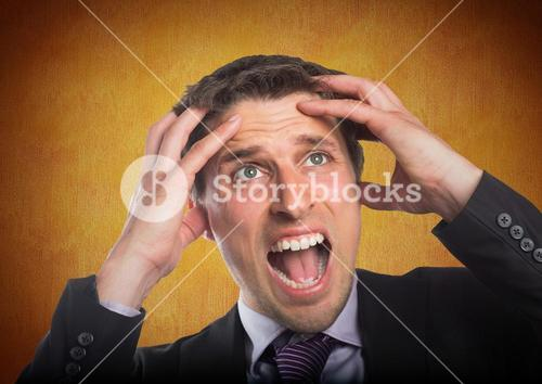 Business man hands on head against orange wall