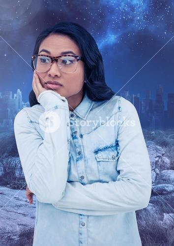 Worried pondering woman against starry night sky
