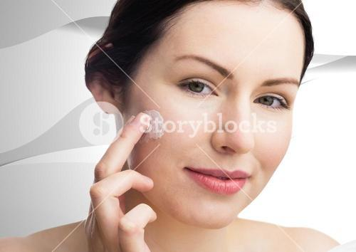 Woman with cream on face against white texture