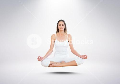 Woman Meditating floating against grey background