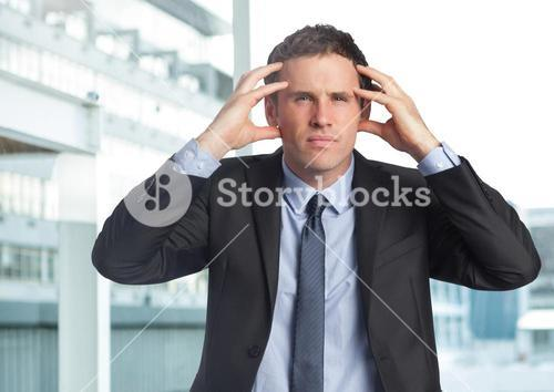 Stressed businessman in business district
