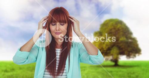 Woman Meditating relaxing by field and tree