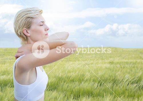 Woman meditative calm relaxing by nature field