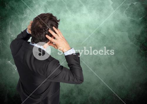 Stressed man against green background with smoke