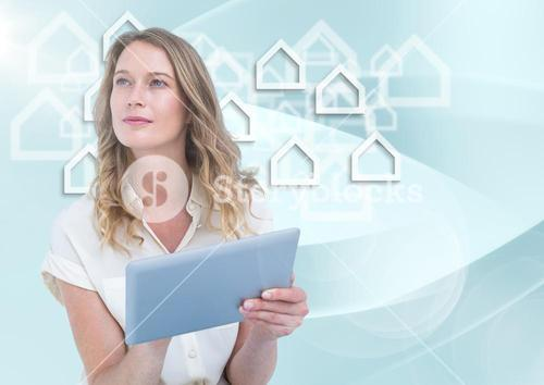 Woman with tablet against white house graphics and blue background