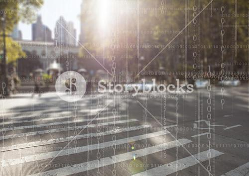 White binary code against blurry street with flare