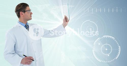 Man in lab coat and goggles with pen holding up glass device against white interface with big flare