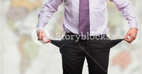 Business man pulling outpockets against blurry map