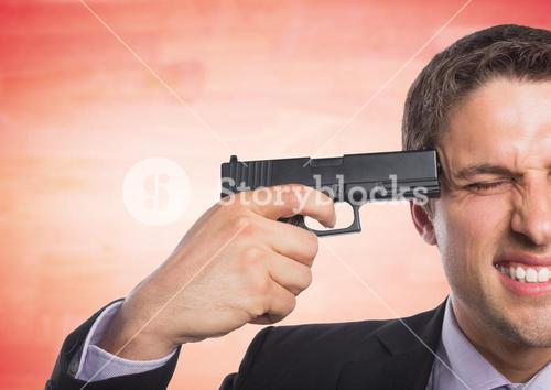 Business man with gun to head against blurry red wood panel