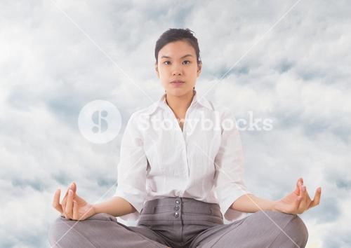 Woman Meditating by clouds