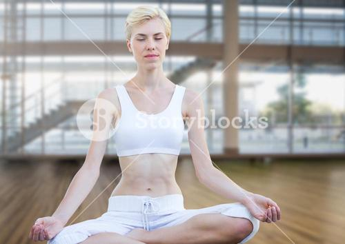 woman Meditating peacefully in gym