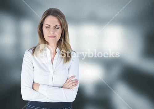 Upset stressed businesswoman against blurred background