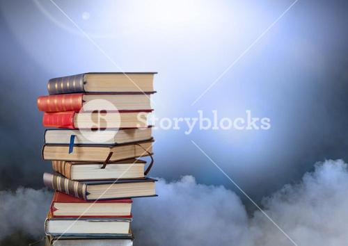 Books stacked by atmospheric clouds