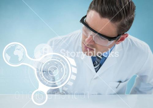Man in lab coat leaning over table looking at white interface against blue background