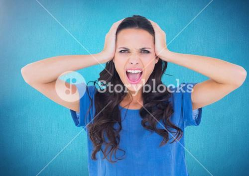 Stressed woman against blue background