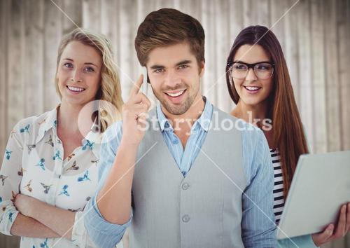 Three people with phone and laptop against blurry wood background