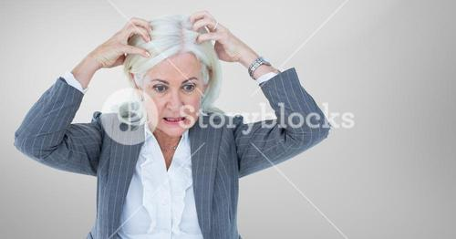 Stressed older woman against grey background