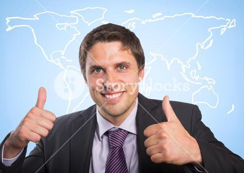 Business man with two thumbs up against white map and blue background