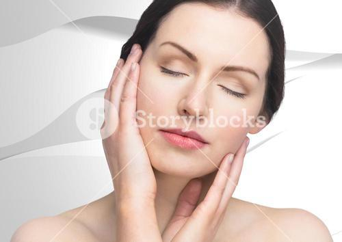 Woman with hands on face against white texture