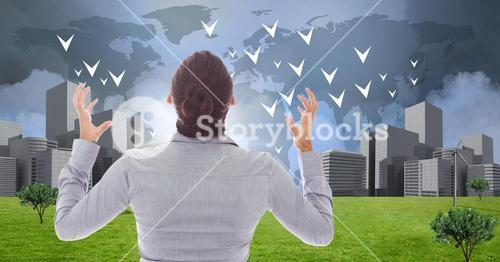 Businesswoman powerful with hands crooked open looking at City with world map
