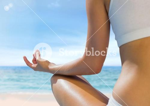 Woman Meditating by sea
