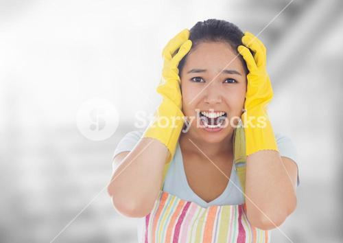 Stressed cleaning lady against bright background