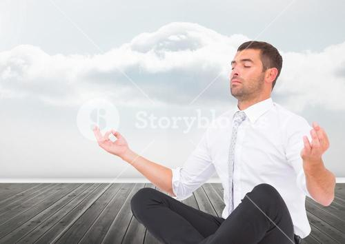 Man Meditating peaceful by clouds