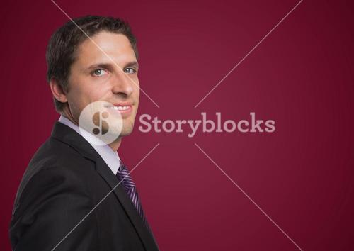 Business man portrait against maroon background